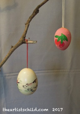 Chinese zodiac animal painted egg (left), Chinese appliqué egg.