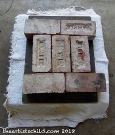 Bricks act as weights on press